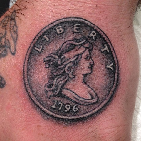 Silver Dollar Tattoo, coin tattoo, money tattoo, black and grey tattoo, hand tattoo, Provincetown tattoo, Cape Cod tattoo, Ptown tattoo, truro, wellfleet, custom tattoo, coastline tattoo