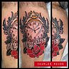 Charles Rouse - clock and rose tattoo