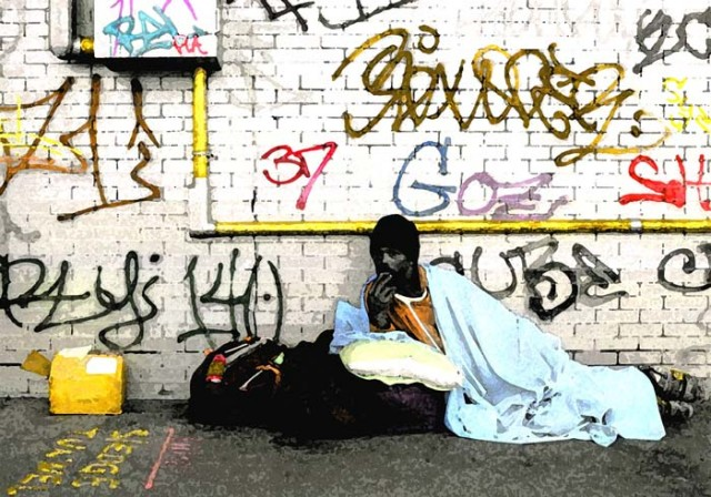 Man with blue blanket and graffitti