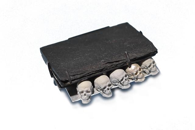 brooch, skulls