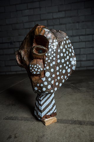 Head with glass eye and polka dots