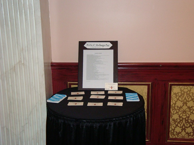 Table with Business Cards, Comment books and The Secret Covenant - Photo by Jessica Cormier