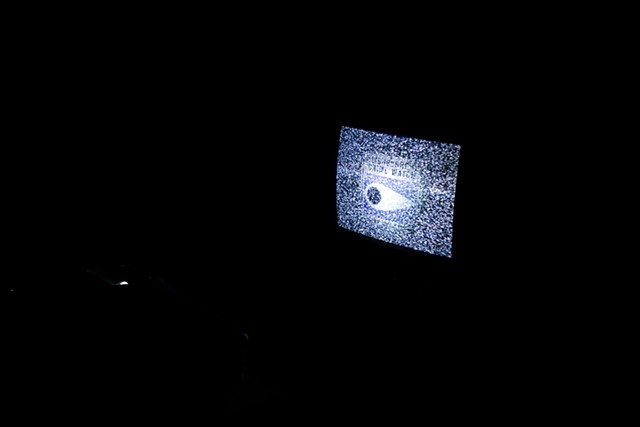 Neighborhood Watch 1 of 3 video projections upon old televisions