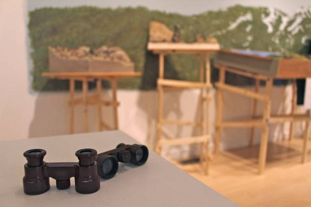 Vintage binoculars with the found dioramas & their supports in the background
