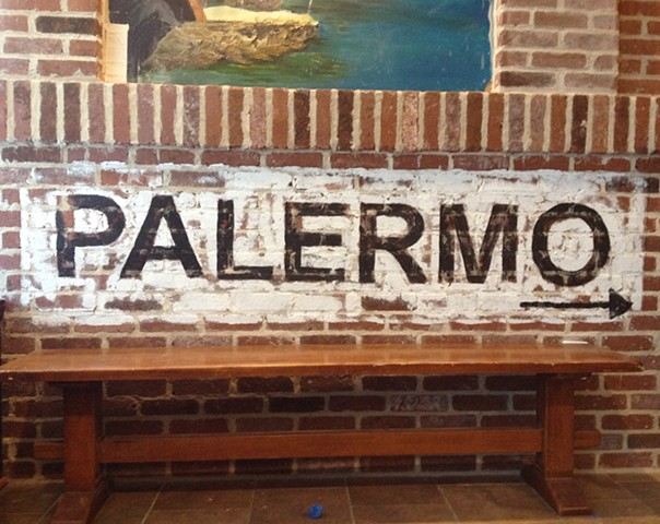 "Hand painted ""Palermo"" on brick"