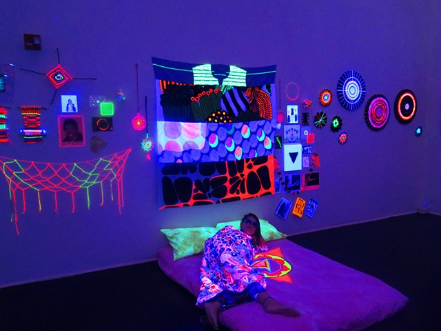 black light glow installation queer contemporary art inner space weaving