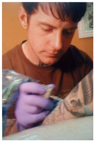 Me getting tattooed by Steven Burlton...way back.