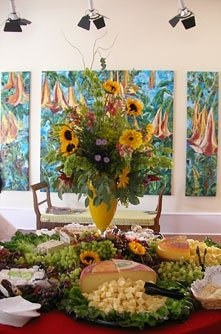 Centerpiece for gallery reception in front of Angel Trumpet Dance tryptich by Joan Cox