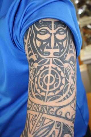 plynesian tattoo sleeve