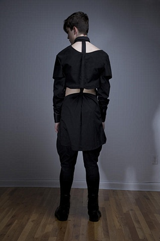 Back of black seamed puzzle shirt