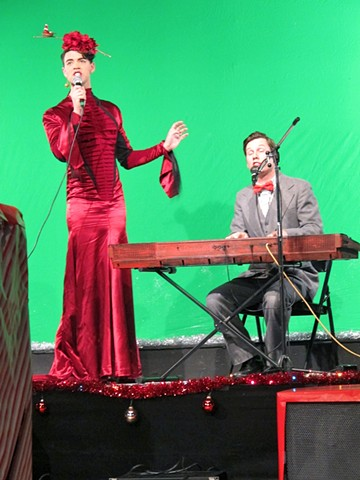 Nicholas Gorham   T.v. Performance in dress and bird with santa hat headpiece