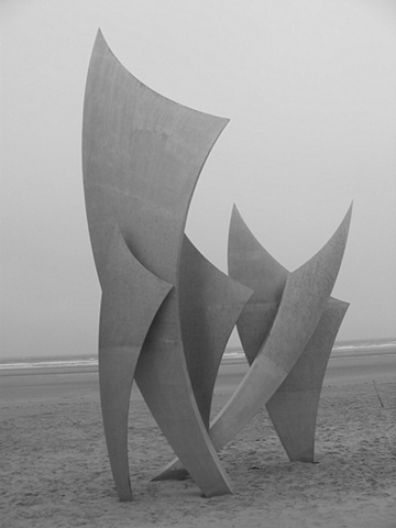 d day sculpture on beach abstract