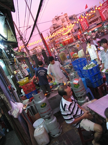 Dinner at a street kiosk, District 10, Ho Chi Minh City.