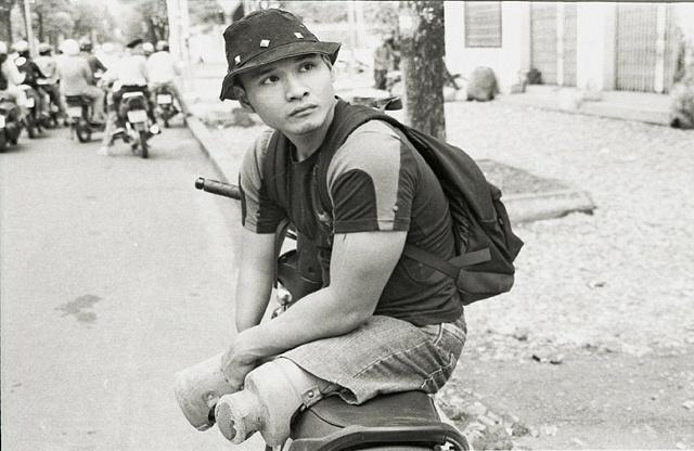 Loi on his custom Motobike.