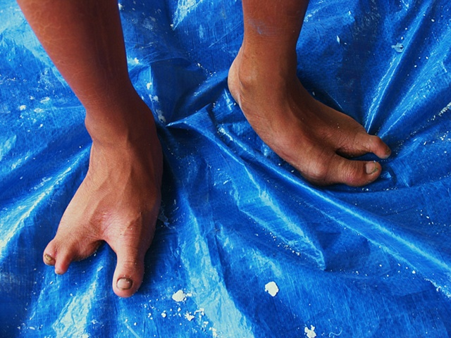 Lo's feet.  He is training in Masonry at a facility outside of Ho Chi Minh city.