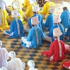 The male elders of the Cao Dai wear diferent colors to represent  the many religious aspects in Cao Dai.  Red is catholocism, yellow Buddhism and Blue for Hindi.