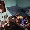 A young child afflicted with Spina Bifida rests at home, Danang