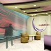•   Interior Perspective: Waiting Area with Interaction Wall