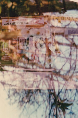 A lo-fi multiple exposure film photo of a vintage cafe sandwich bar in Battersea, London, England, with cherry tree flower blossoms.