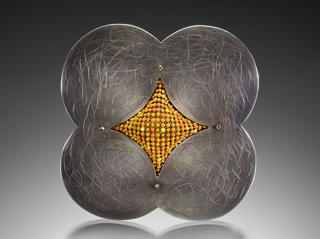 Contemporary art jewelry brooch of sterling silver by Wendy McAllister.