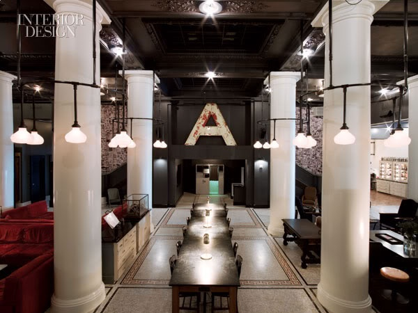 Ace Hotel  Blown glass covers for chandeliers surrounding columns in lobby  Roman and Williams, Argosy Designs, and GFI Capitol  Resources.