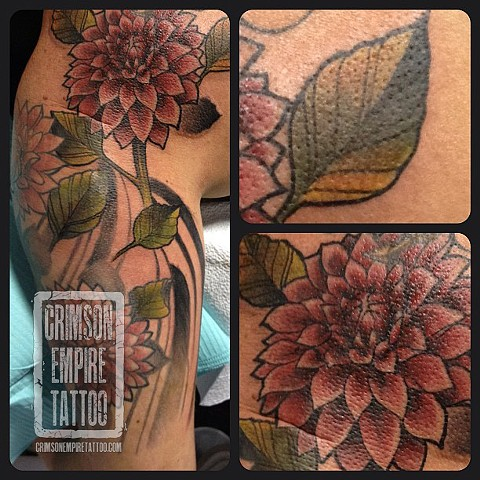 Flower and leave half sleeve on arm by Chad Clothier