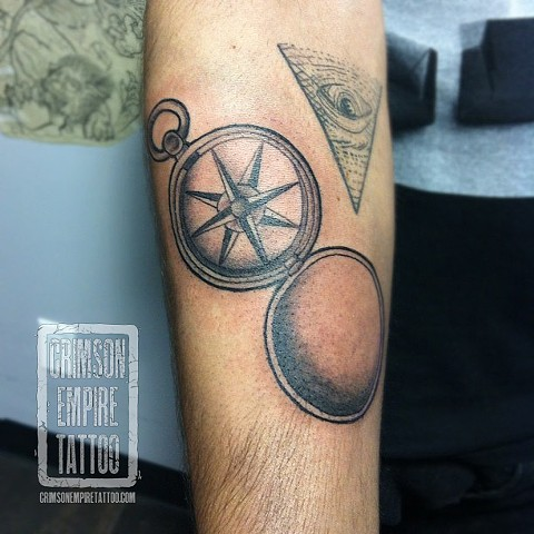 Compass on forearm by Jessica Doyle