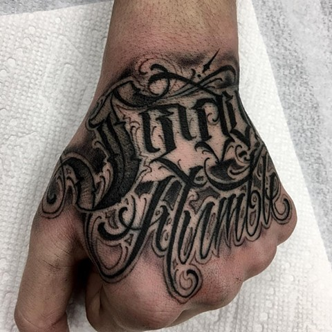 Black and Grey Script Hand Tattoo