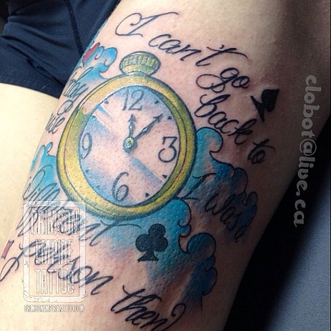 Clock and script on forearm by Chad Clothier
