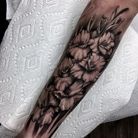 Black and Grey Gladiolus Flower Forearm Tattoo