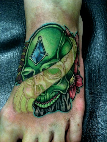 Green Skull on foot