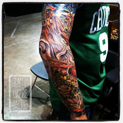 Mask and dragon sleeve on arm by Josh Lamoreux