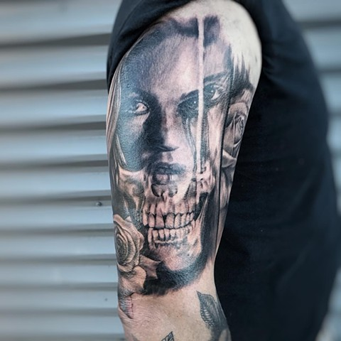 Black and Grey Skull & Face Tattoo