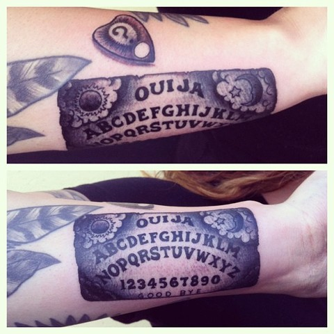Ouija board on arm by Sydney Dyer