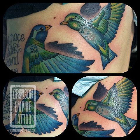 Bird with script on ribs by Jessica Doyle