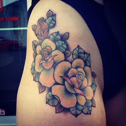Flowers on hip and leg by Sydney Dyer