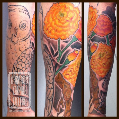 Marigolds and owl on forearm by Curt Semeniuk. Follow Curt @ol_curty_bastard