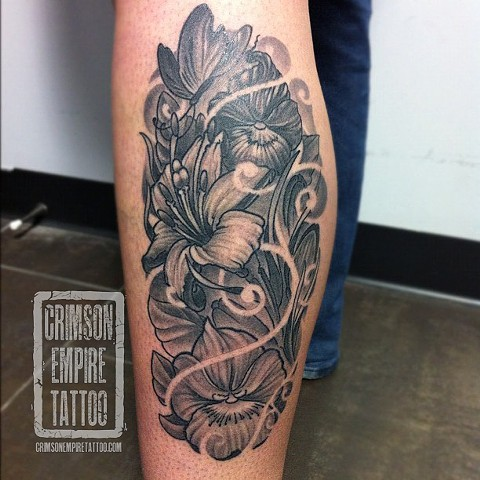 Black and grey flowers on leg by Jared Phair
