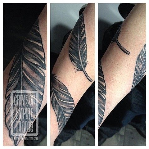 Feather band on arm by Chad Clothier. Follow Chad @clobot