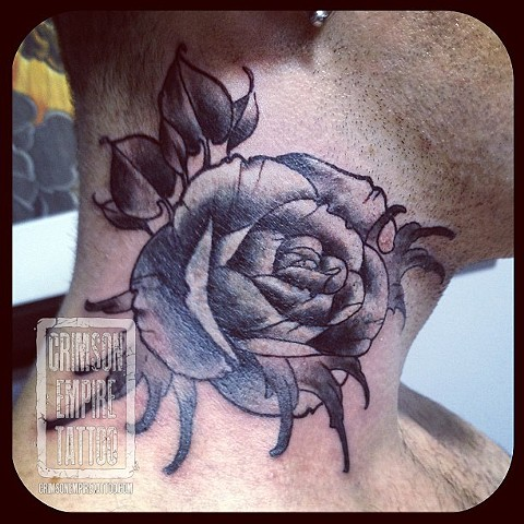 Black and white rose on neck by Chad Clothier