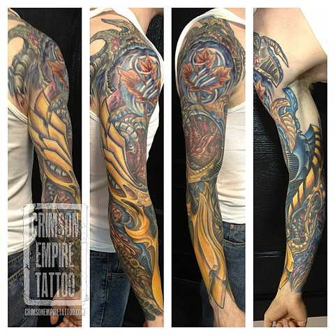 Maple leaf and bio sleeve on arm by Josh Lamoreux. Follow Josh @joshlamoureux