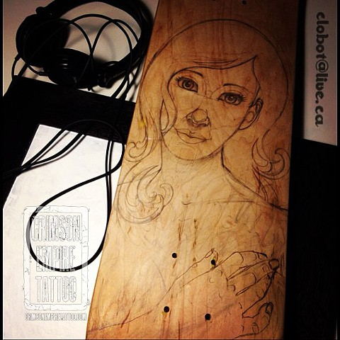 Portrait sketch on wood by Chad Clothier