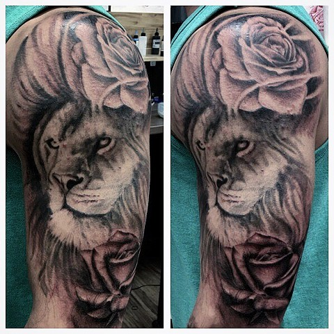 Black and Grey Lion and Rose Upper Arm Tattoo