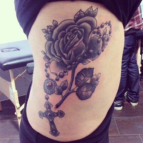 Rose and cross on side by Sydney Dyer