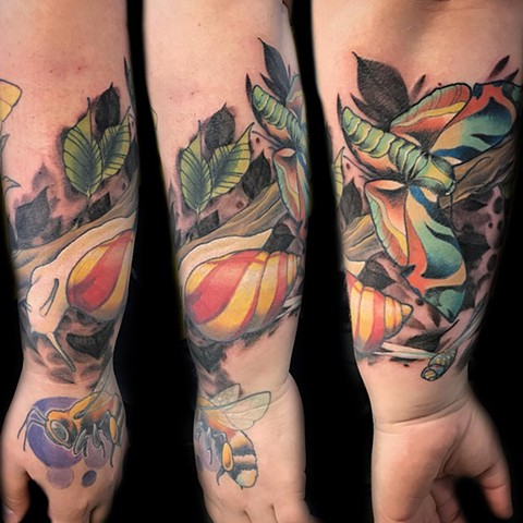 Full colour nature themed tattoo