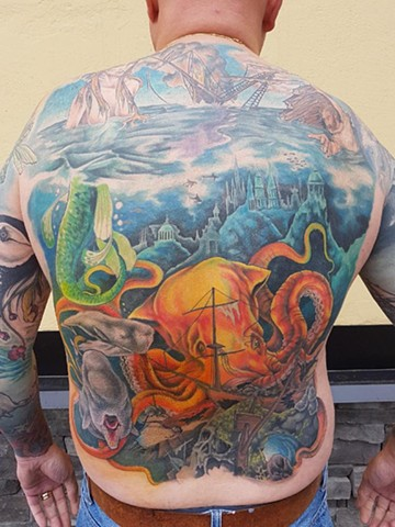 Full colour underwater backpiece tattoo
