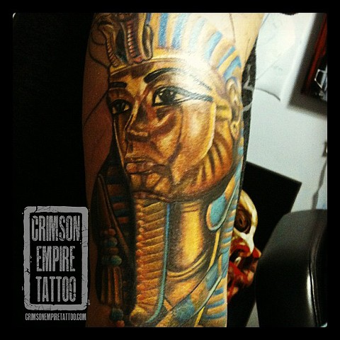 Egyptian statue on arm by Josh Lamoureux