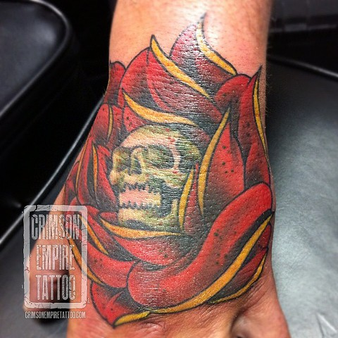 Flower and skull on hand by Jared Phair. Follow Jared @jroctizzle