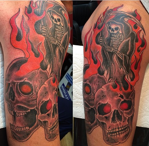 Redue of the 25 year old Reaper & Flames, I added the skulls.