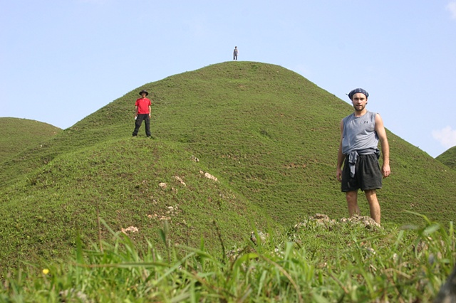 Three men on hills